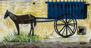 Carro con cavallo disegnato su muro